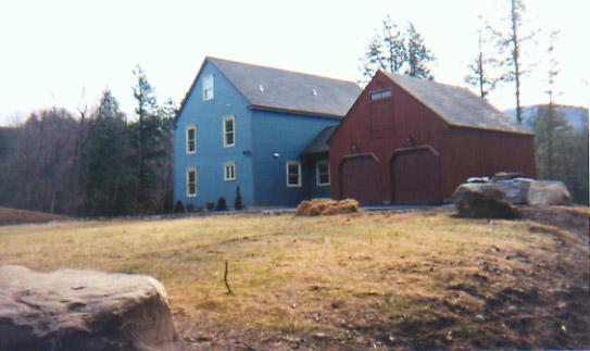 Barn-style garage alongside a Smith Building Company custom built home