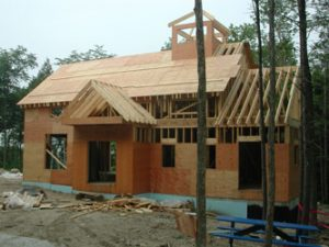 Custom-built home with exterior walls in progress