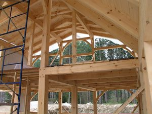Exposed timber frame of a Smith Building Company custom-built home